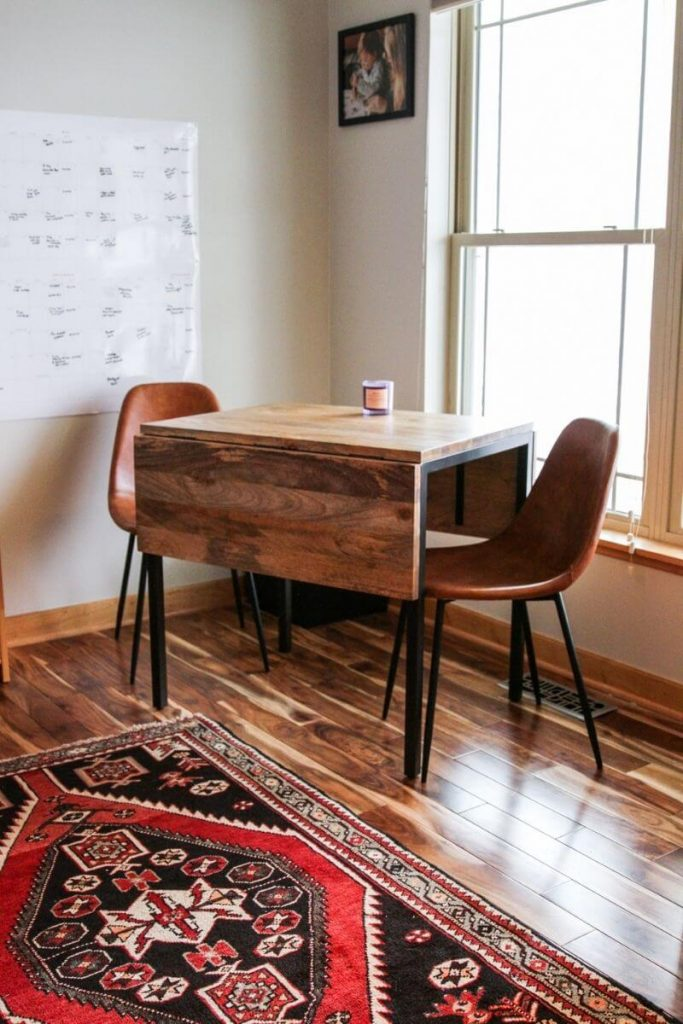Wooden table and leather chairs for home office